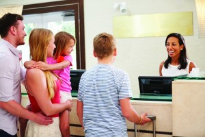 family at front desk