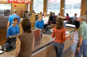Customers ordering in a QSR