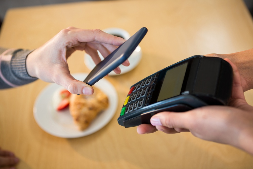making payment through smartphone in cafeteria